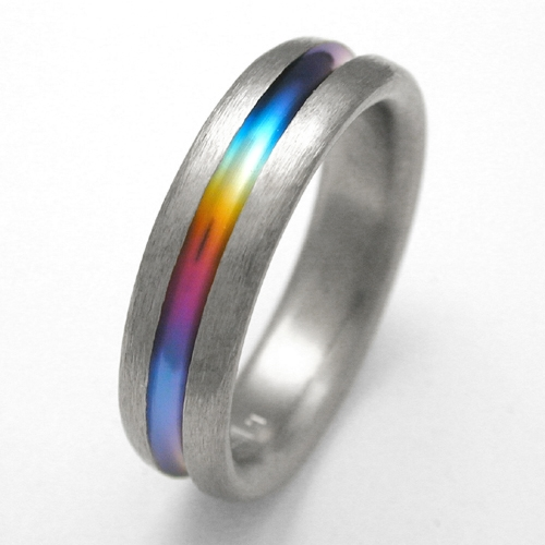 Making the rainbow solid Titanium Wedding Rings Handcrafted by