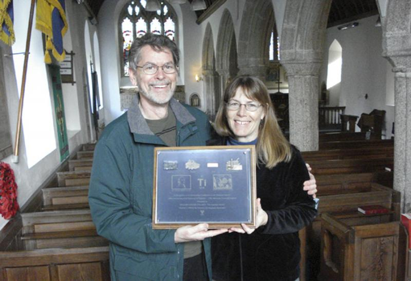 Chris and Sandy Boothe, with the plaque