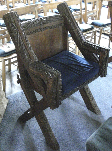 A chair made from roof beams of the original church