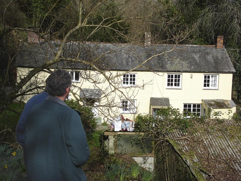 Chris and Derek look toward the house