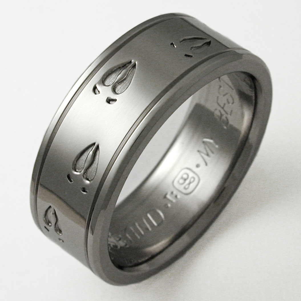 durango 1 mens titanium wedding band Durango 1 titanium ring with animal tracks Titanium Wedding Rings Handcrafted by Exotica Jewelry